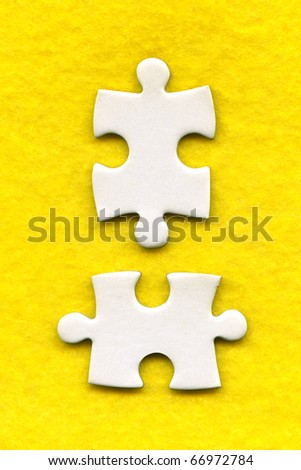 puzzle pieces on a yellow background - stock photo