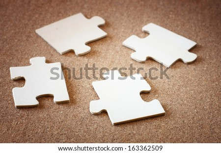 puzzle pieces on wooden background. business or team concept. selective focus . - stock photo