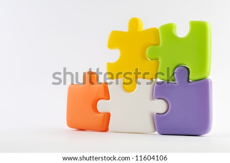 Puzzle pieces together isolated on white