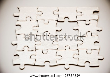 puzzle pieces with missing peace - stock photo