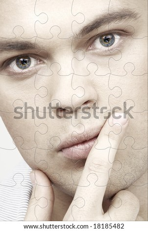 puzzle portrait of handsome man with blue eyes - stock photo