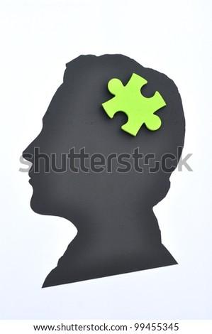 Puzzle psychology - stock photo