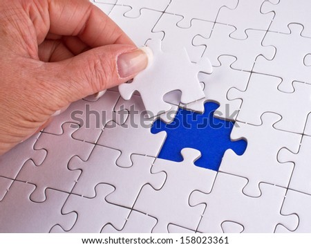 Puzzle with female Hand - stock photo