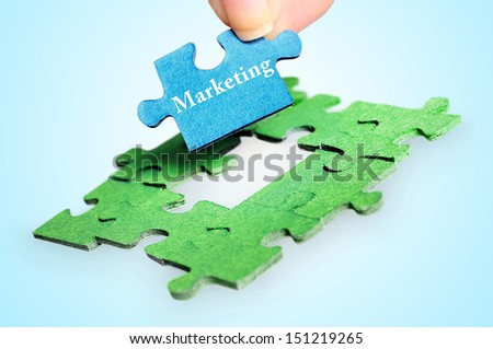 Puzzle with marketing word piece - stock photo