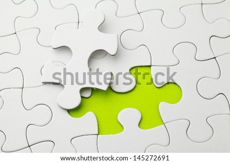 Puzzle with missing piece in green color - stock photo