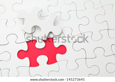 Puzzle with missing piece in red color - stock photo
