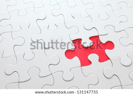 puzzle with missing red piece - stock photo