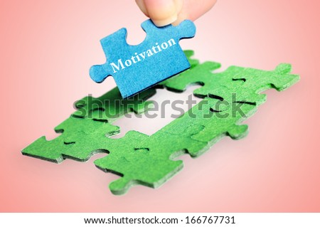 Puzzle with Motivation word piece - stock photo