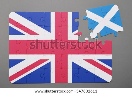 Puzzle with national flag of great britain and scotland piece detached. Concept - stock photo