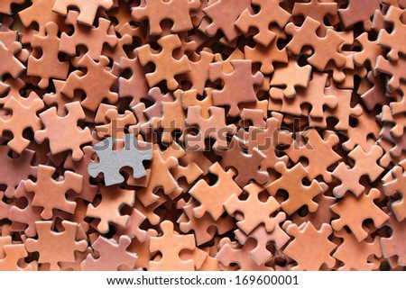 Puzzle with one upside down piece - stock photo