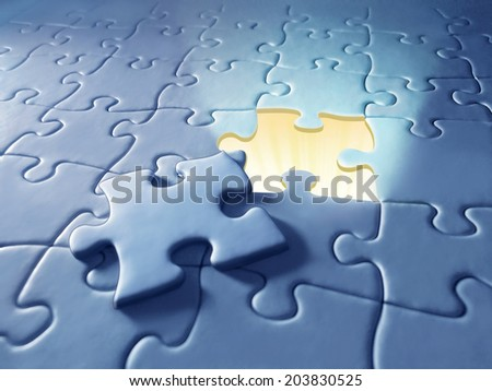 Puzzle with shining light - stock photo
