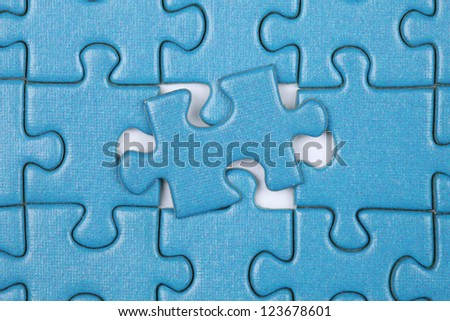 Puzzle with the last missing piece put in place