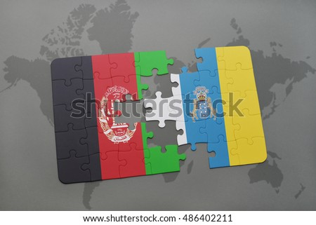puzzle with the national flag of afghanistan and canary islands on a world map background. 3D illustration