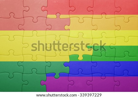 puzzle with the national flag of bolivia and gay flag.concept - stock photo