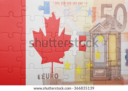 puzzle with the national flag of canada and euro banknote . concept - stock photo