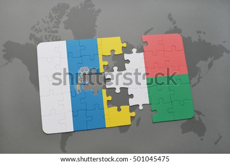 puzzle with the national flag of canary islands and madagascar on a world map background. 3D illustration