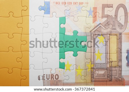 puzzle with the national flag of cote divoire and euro banknote . concept - stock photo