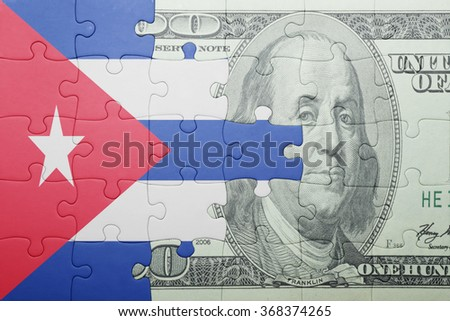 puzzle with the national flag of cuba and dollar banknote . concept