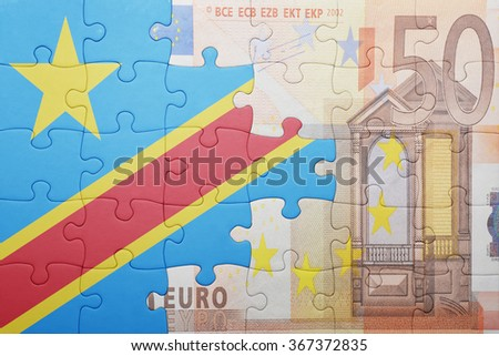 puzzle with the national flag of democratic republic of the congo and euro banknote . concept - stock photo