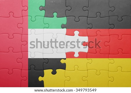 puzzle with the national flag of germany and united arab emirates. concept - stock photo