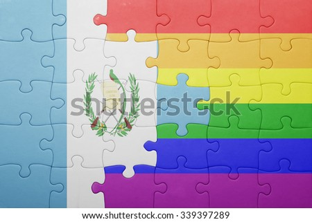 puzzle with the national flag of guatemala and gay flag.concept - stock photo