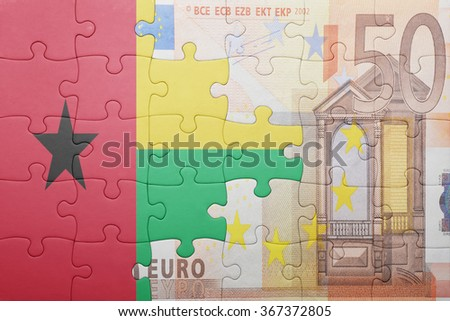 puzzle with the national flag of guinea bissau and euro banknote . concept - stock photo