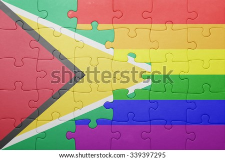 puzzle with the national flag of guyana and gay flag.concept - stock photo