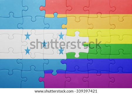 puzzle with the national flag of honduras and gay flag.concept - stock photo