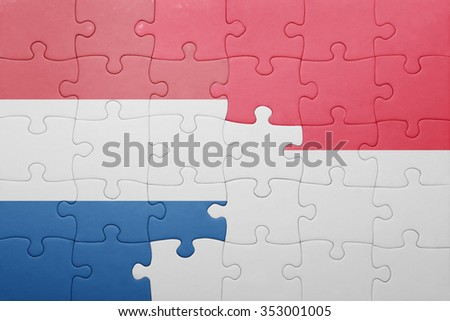puzzle with the national flag of indonesia and netherlands . concept