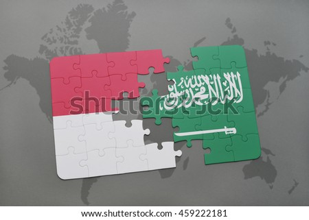 puzzle with the national flag of indonesia and saudi arabia on a world map background. 3D illustration
