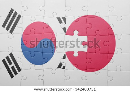 puzzle with the national flag of japan and south korea . concept - stock photo