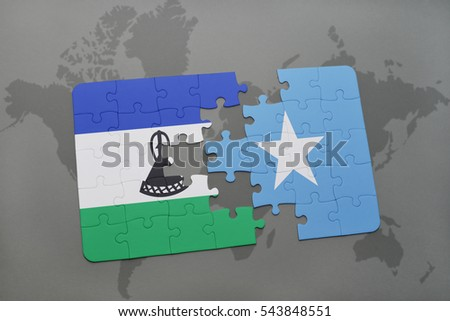 puzzle with the national flag of lesotho and somalia on a world map background. 3D illustration