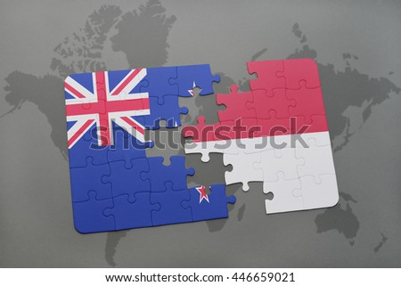 puzzle with the national flag of new zealand and indonesia on a world map background. 3D illustration