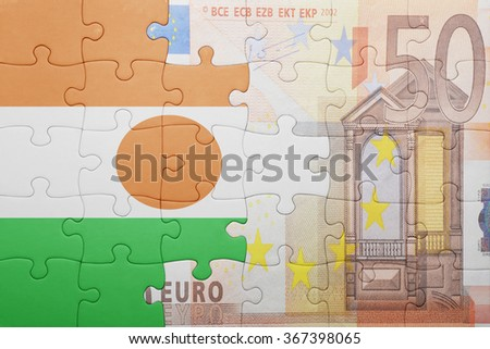puzzle with the national flag of niger and euro banknote . concept - stock photo