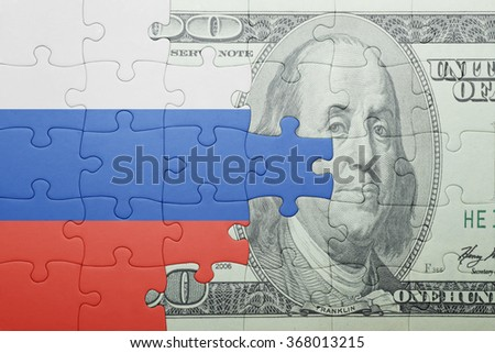 puzzle with the national flag of russia and dollar banknote . concept - stock photo
