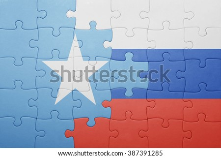 puzzle with the national flag of russia and somalia . concept
