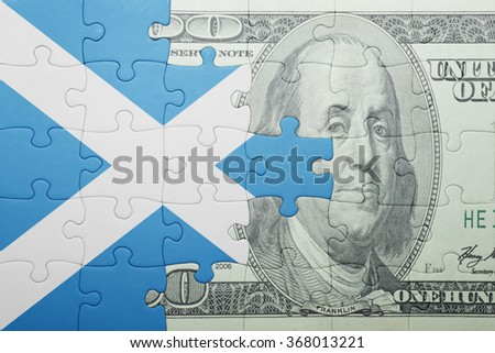 puzzle with the national flag of scotland and dollar banknote . concept