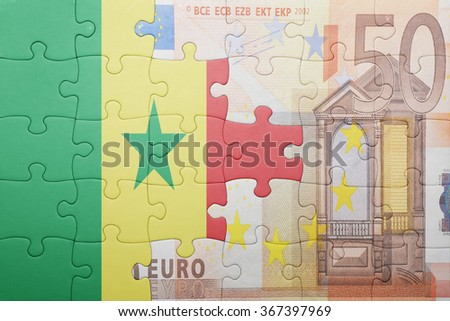 puzzle with the national flag of senegal and euro banknote . concept - stock photo