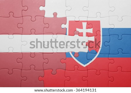 puzzle with the national flag of slovakia and latvia . concept
