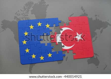 puzzle with the national flag of turkey and european union on a world map background. - stock photo