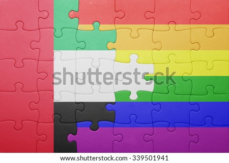 puzzle with the national flag of united arab emirates and gay flag.concept - stock photo