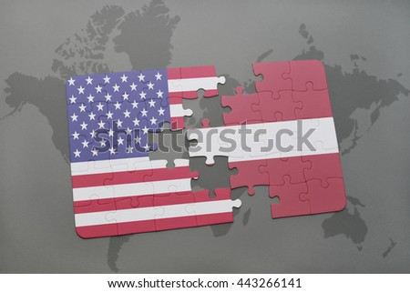 puzzle with the national flag of united states of america and latvia on a world map background - stock photo