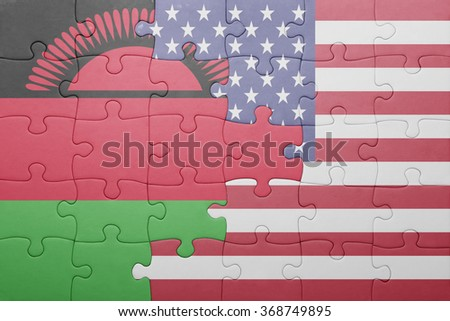 puzzle with the national flag of united states of america and malawi .concept