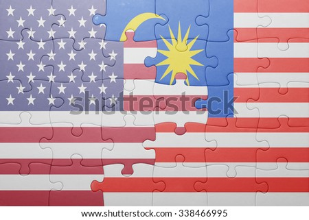 puzzle with the national flag of united states of america and malaysia.concept