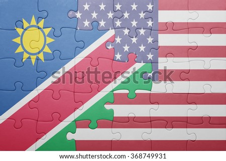 puzzle with the national flag of united states of america and namibia .concept