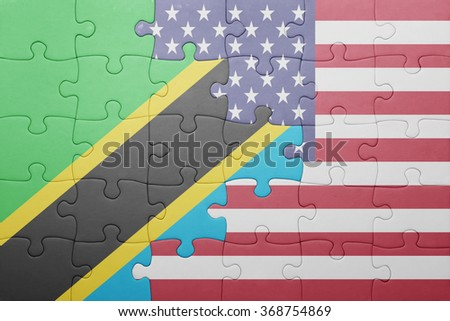 puzzle with the national flag of united states of america and tanzania .concept - stock photo