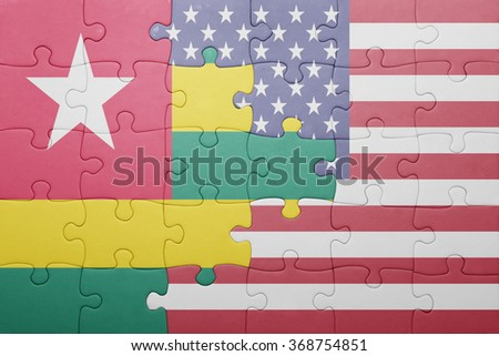 puzzle with the national flag of united states of america and togo .concept - stock photo