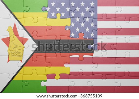 puzzle with the national flag of united states of america and zimbabwe .concept - stock photo