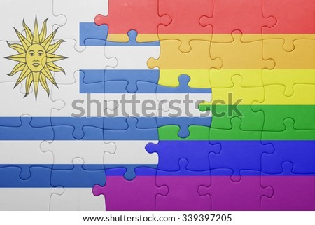 puzzle with the national flag of uruguay and gay flag.concept - stock photo