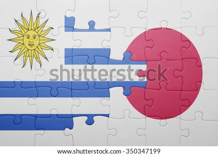 puzzle with the national flag of uruguay and japan. concept